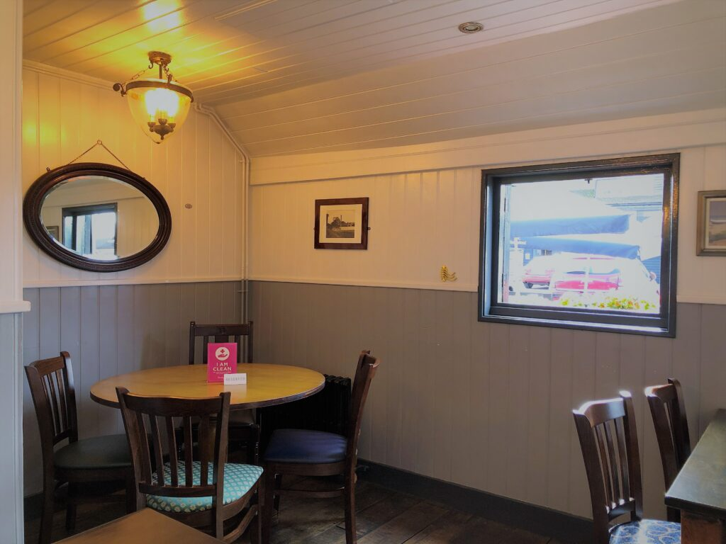 dining tables and attractive barge boarded interior at The Barge Inn Battlesbridge Essex
