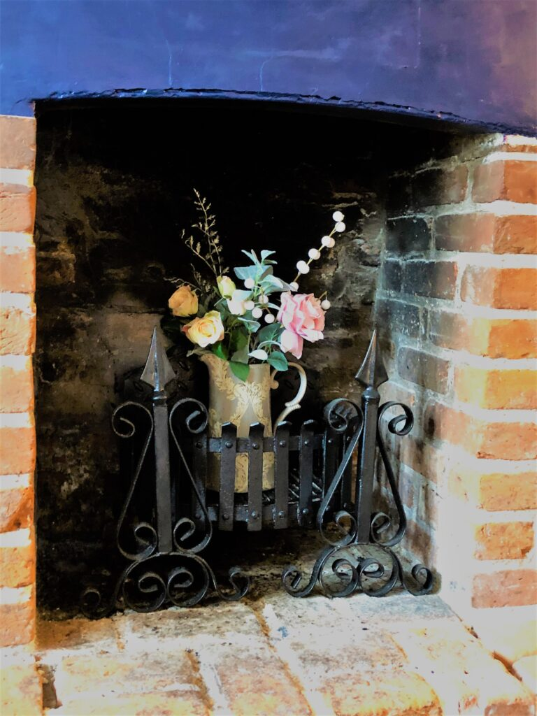 decorative summer fireplace Barge Inn Battlesbridge Essex