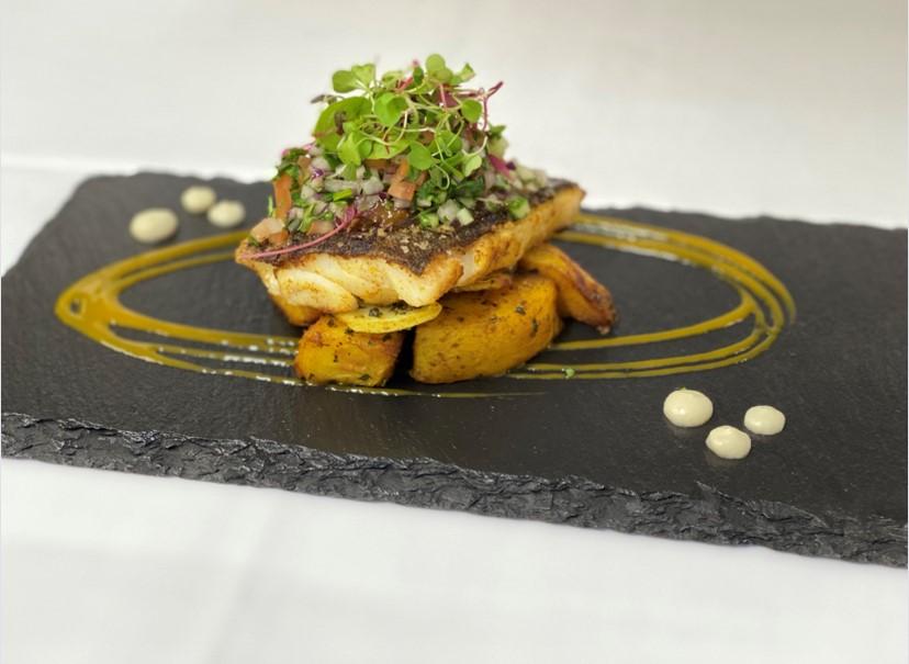 Main -Spiced Cod fillet-Bombay potato-Indian salad-curried cauliflower purée-textures of mango barge Inn battlesbridge chef's specials